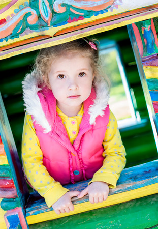 carefully: cute little girl playing on the playground Stock Photo