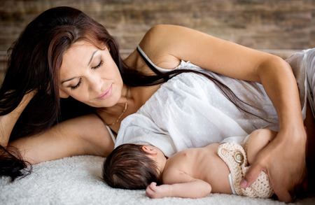 beautiful breasts: beautiful mother feeding her newborn with breast