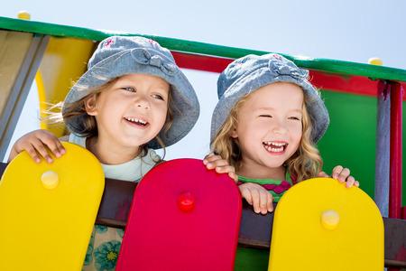 happy little children on the playground  in summer photo