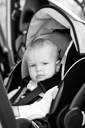 slobber: Cute little boy in car seat ( black and white ) Stock Photo