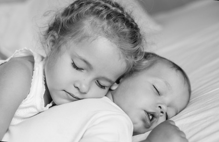 matron: charming little brother and sister asleep embracing ( black and white )
