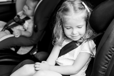Toddler cute kids in car seats summer  ( black and white )