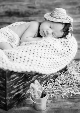 fancy sweet box: cute newborn baby boy sleeping in a hat fisherman ( black and white )
