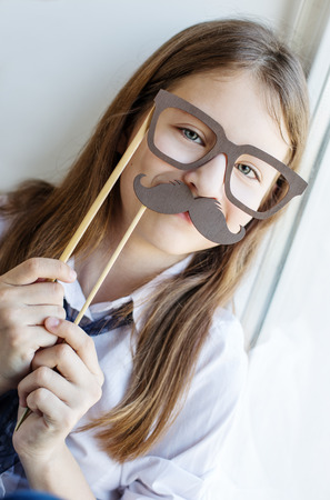 model home: Portrait of a schoolgirl in funny glasses and a mustache