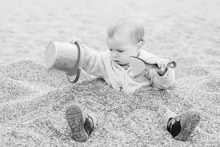 Funny toddler boy playing ( black and white ) photo