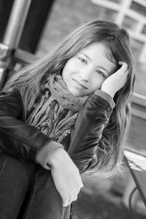 preteen model: portrait of a girl 13 years outdoors ( black and white )