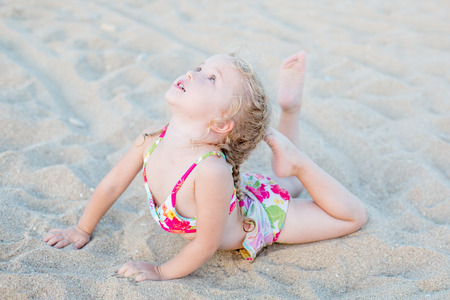 little girl swimsuit: cute little girl on the beach stretch