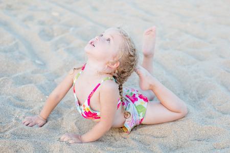 little girl swimsuit: cute little girl on the beach stretch