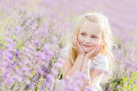 lavanda: portrait smiling toddler girl in lavender field