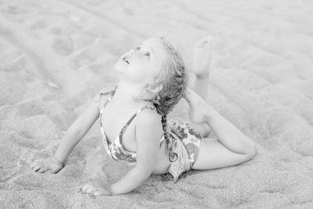 beach girl: cute little girl on the beach stretch ( black and white )