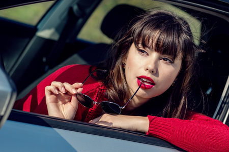 25 35: attractive young woman driving a car on a sunny day Stock Photo