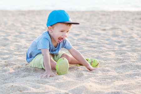 toddler boy: Toddler boy playing on the beach in summer