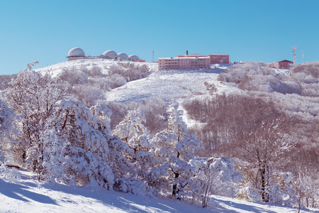 meteorological: meteorological station high in the mountain in the winter