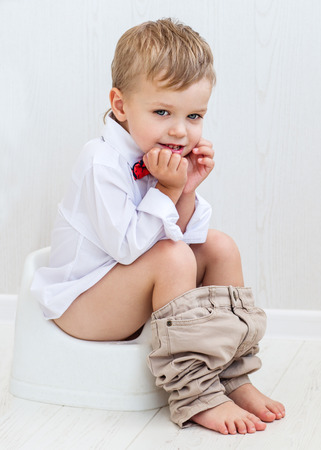 cute smiling child on a pot on a white background