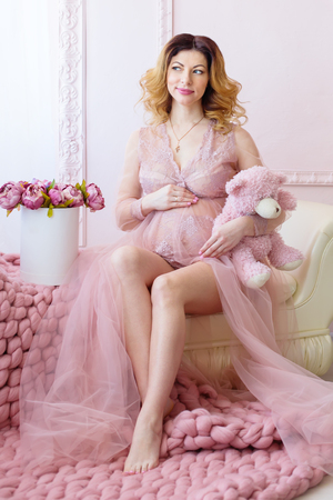 boudoir: Beauty Pregnant Woman . Pregnant Belly. Beautiful Pregnant Woman Expecting Baby. Maternity concept.