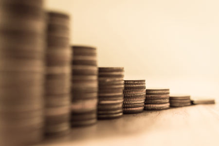 Coins stack step growing growth saving money, Concept finance business investment, selective focus, Vintage tone Standard-Bild