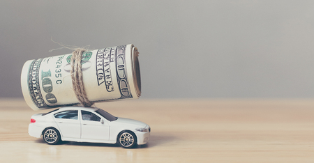Money row bill us dollar on white miniature car Stock Photo - 93134510