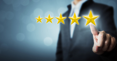 Businessman pointing five star symbol to increase rating of company