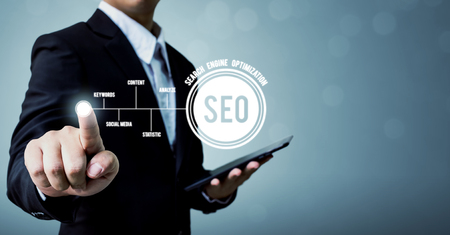 Key concept search engine optimization social network, Businessman hand pointing dot with text SEO