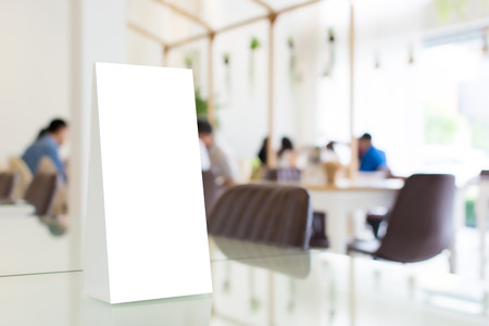 Mock up blank template menu frame in restaurant with blurred background, Clipping path included Stockfoto
