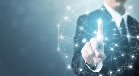 Businessman hand touching global network connection system with space for your message
