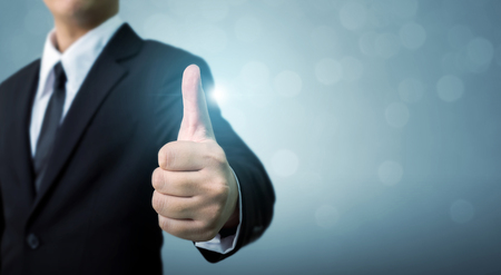 Businessman showing OK or hand sign thumb up, The excellence of the business or service concept, Copy space Stok Fotoğraf