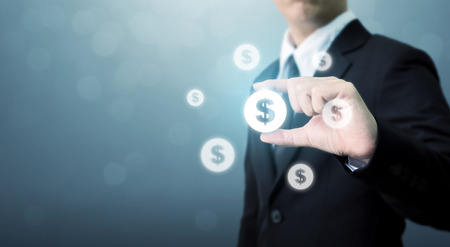 Businessman holding dollar currency icon, Successful money financial investment concept 写真素材