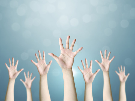 Group of hand raise up many people, International volunteer day and community service concept