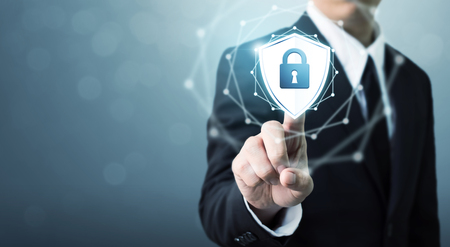 Businessman touching shield protect icon, Concept cyber security safe your data Foto de archivo