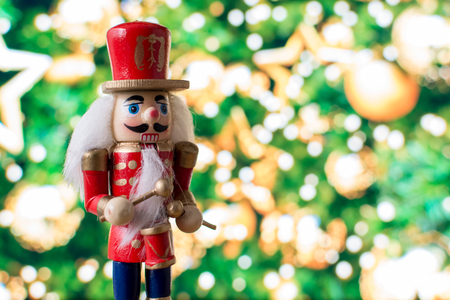 Christmas nutcracker toy soldier traditional figurine with bokeh background Stok Fotoğraf