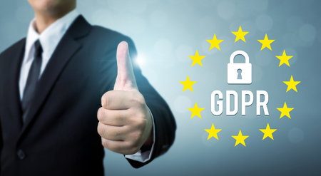Businessman hand thumb up and sign general data protection regulation (GDPR) and key icon