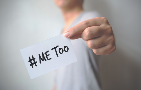 "Close up hand of young man holding show a white card with word ""Me Too"". Social movement concept Stock Photo"