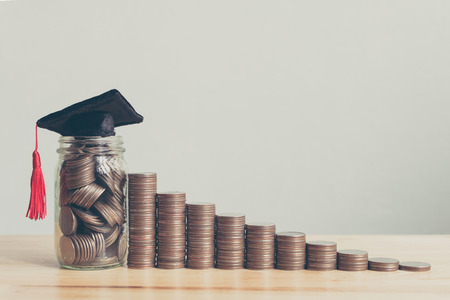 Scholarship money concept. Coins in jar with money stack step growing growth saving money investment