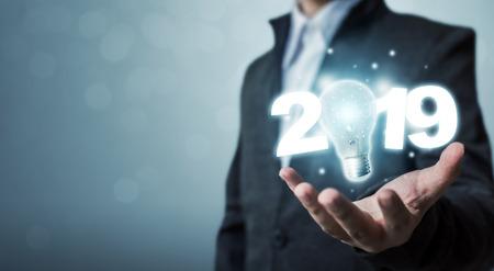Businessman hand holding light bulb with year 2019 idea innovation technology concept