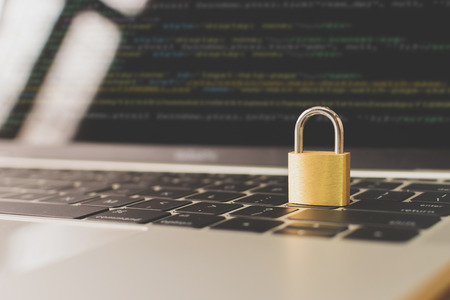 Protection network security computer and safe your data concept. Laptop working develop coding program with key on keyboard Stock Photo