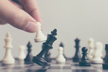 Plan leading strategy of successful business competition leader concept, Hand of player chess board game putting white pawn, Copy space for your text Stock Photo
