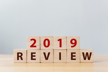 2019 review concept. The word REVIEW on wooden cube block on wood table