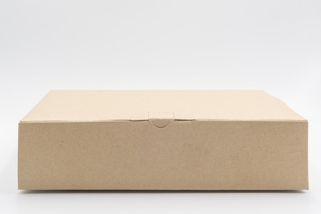 Closed blank cardboard brown box isolated on white background