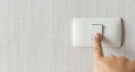 Concept save energy. Hand turning off switch