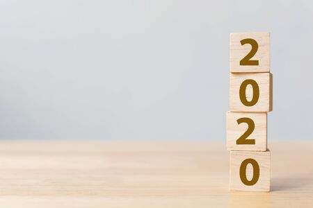 New year resolution 2020 concept. Wooden block cube with year number on table