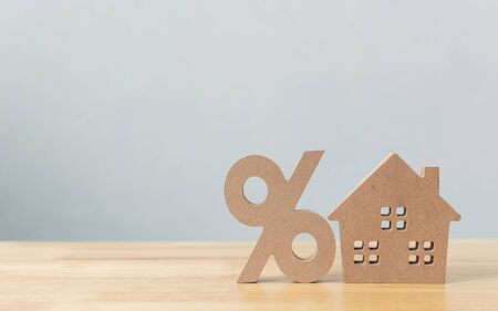 Percentage and house sign symbol icon wooden on wood table with white background