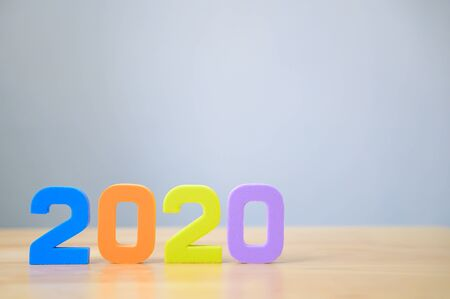 New years resolution 2020 concept. Colourful number on table with copy space for your text