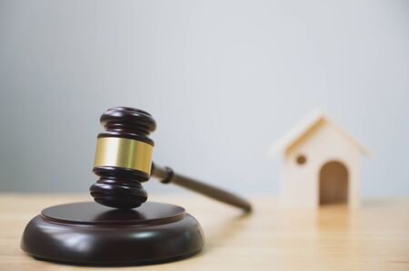 Law and justice, legality concept, Judge gavel and house on wooden table