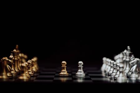 Business competition and strategy plan concept. Chess board game gold and silver colour Stock Photo