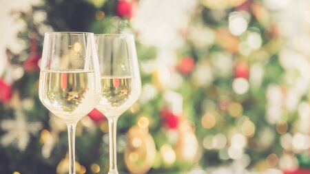 Christmas and new year eve party with champagne and blurred background ornament decorated tree