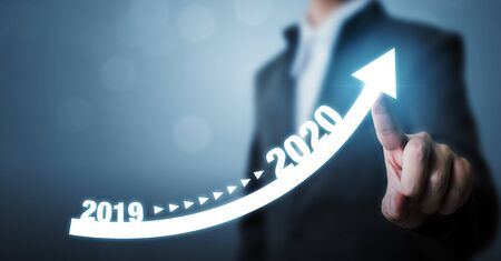 Business development to success and growing growth year 2019 to 2020 concept, Businessman pointing arrow graph corporate future growth plan