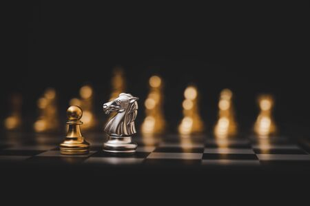 Business competition and strategy plan concept. Chess board game gold and silver colour Stock fotó