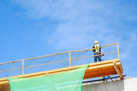 Engineer working on high ground construction site. Wear a helmet safety and uniform staff