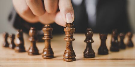 Panoramic image. Businessman with chess board game. Plan stratgy and tactic concept Stock fotó