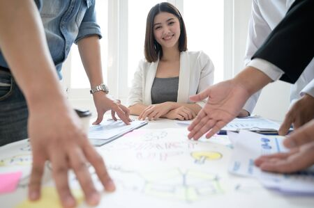 Beautiful young asian businesswoman are meeting their teammates and paperwork document on desk Stock Photo
